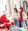 Children Taking Biscuits From Santa Claus