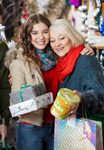 Affectionate Mother And Daughter With Christmas Presents