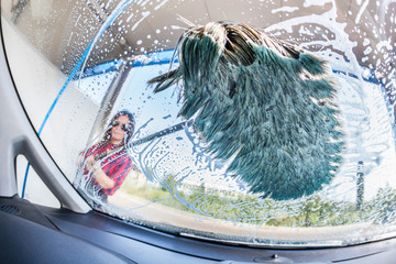 Young Woman Washing Car, interior view