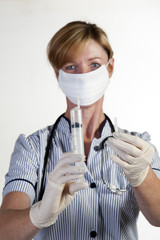 Nurse in surgical gloves holding syringe
