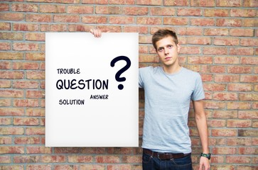Young man holding whiteboard with question and solution words