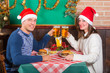 Young Couple Enjoying Christmas Dinner