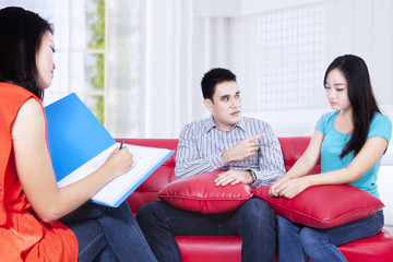 Young couple consultation talking to a psychologist