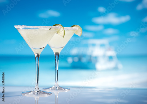 margarita  cocktail on beach, blue sea and sky background