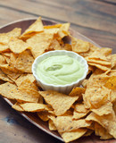 A plate of chips and guacamole