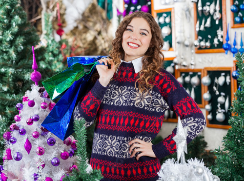 Beautiful Woman Carrying Shopping Bags In Store
