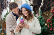 Couple With Christmas Present At Store