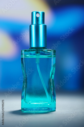 Women perfume in beautiful bottle on bright background