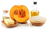 Cut pumpkin with ingredients for cooking isolated on white