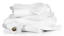 """Постер, картина, фотообои """"Stack of clean bedding sheets and towels isolated on white"""""""