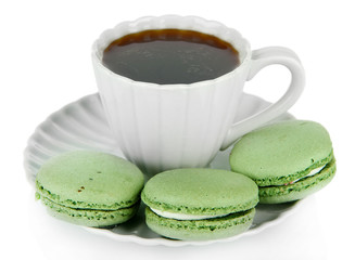 Coffee and macaroons isolated on white