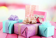 Beautiful bright gifts, on bright wooden table