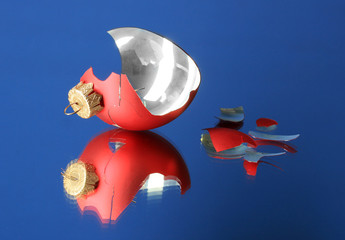 Broken Christmas Toy on blue background