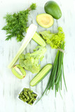 Fresh green vegetables, on wooden background