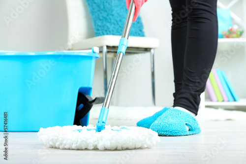 Mopping floor at home close-up