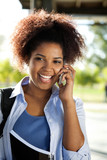 Female Student Answering Mobilephone On Campus