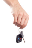 Male hand holds a car key and an alarm control