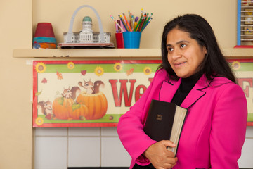 Woman Embracing the Bible in Home School Environment