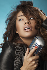 Singing Woman with Retro Microphone. Beauty Glamour Singer
