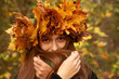 girl in yellow leaves crown