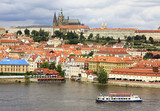 Motor ship on the river Vltava in the background Prague Castle.