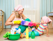 mother with kid cleaning room and having fun