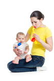 Mother and baby girl playing musical toys