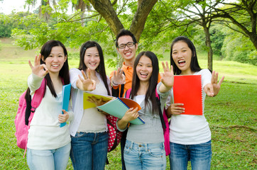 Asian students making ok sign