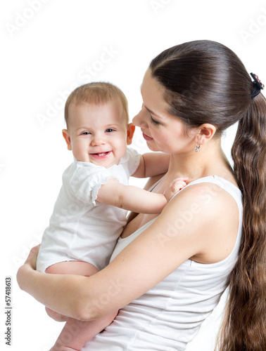 beautiful mother holding baby girl isolated on white