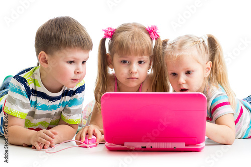 group of kids friends looking at the laptop