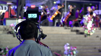 Cameraman with television shoots happening on stage