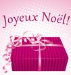 Joyeux noël ! Carte paquet cadeau sur fond rose.