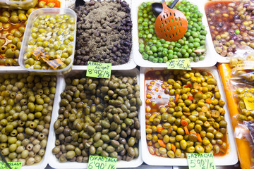 marinated olives in cans at  market