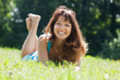brunette woman in  grass