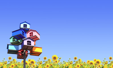 Colorful nesting boxes and sunflowers
