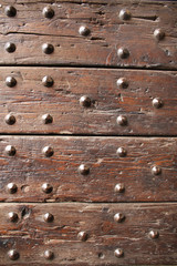 Ancient wood with rivets