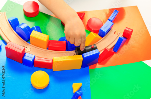 little boy playing with toys, early education