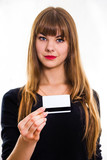 The young girl holds out business card.