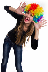 On the head of the cheerful girl multi-colored wig
