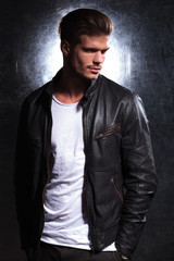 smiling fashion man wearing a leather jacket