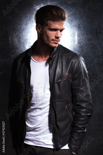 smiling fashion man wearing a leather jacket