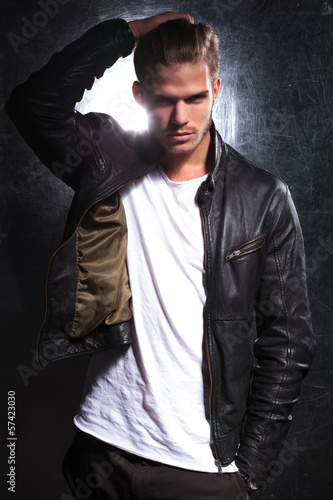 fashion model moving his hand through his long hair