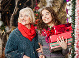 Mother And Daughter With Christmas Presents In Store