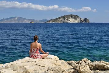 woman meditating on a seacoast