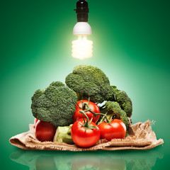 healthy produce concept photo with cfl bulb