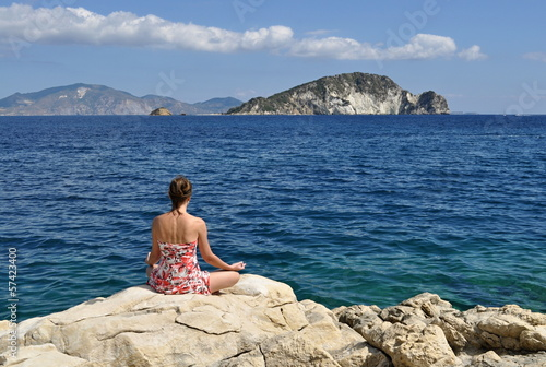 woman meditating on a seacoast
