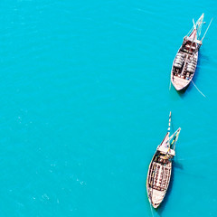 Top view of vintage boats in cyan blue transparent sea water