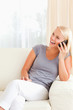 Portrait of a laughing woman on the phone