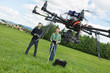 Engineers Flying UAV Helicopter in Park