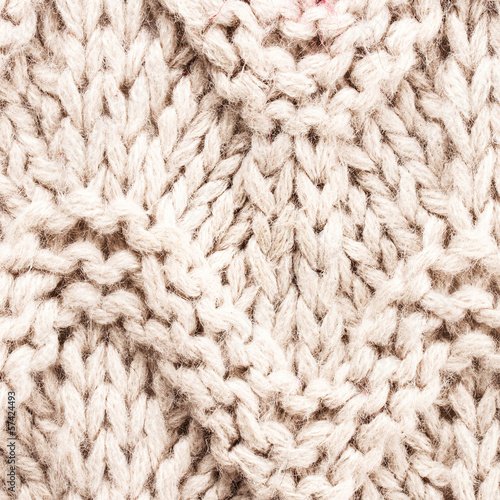 White knitting background texture. Knit woolen Fabric textile mu